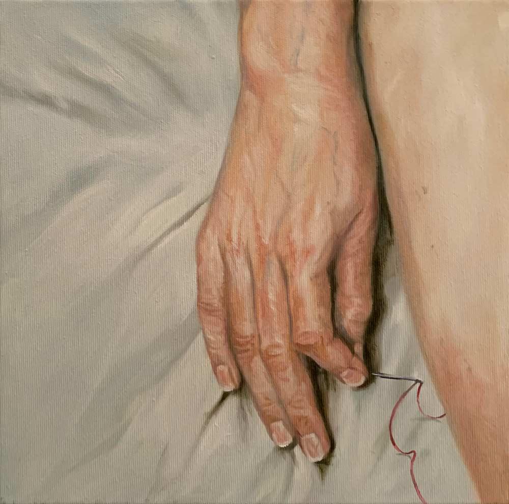 Hand und Nadel
